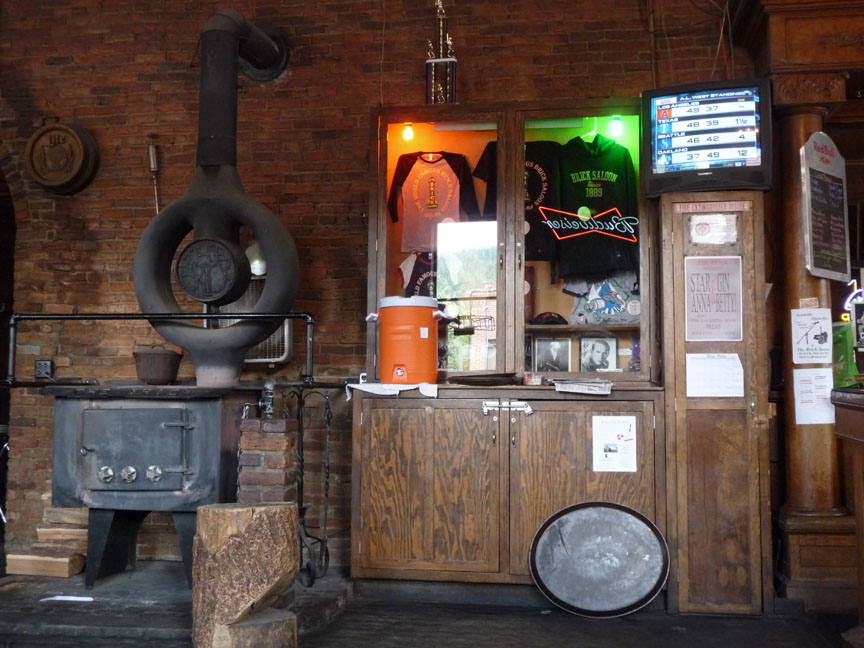 The old wood stove and souvenir display case in the main room