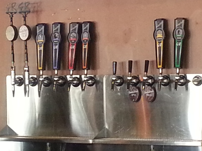 Taps wall behind bar