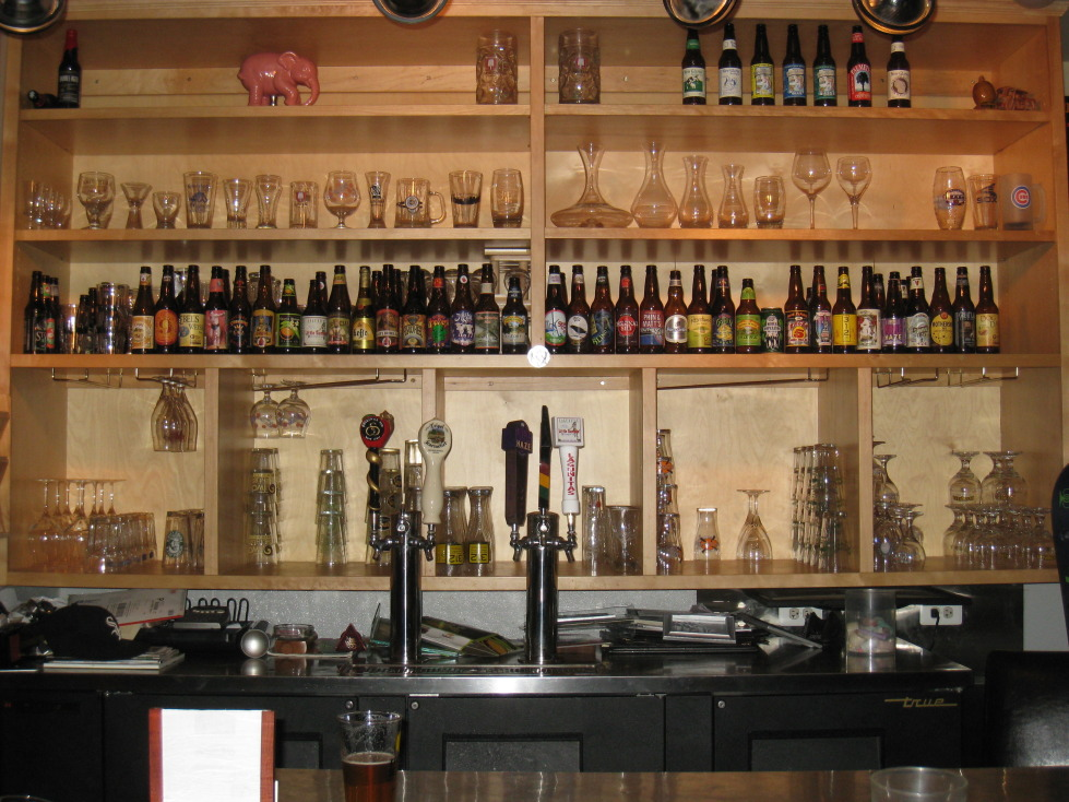 """The Bigby's bottle beer """"menu"""" is this display that is constantly changing.  (Taps are lis"""