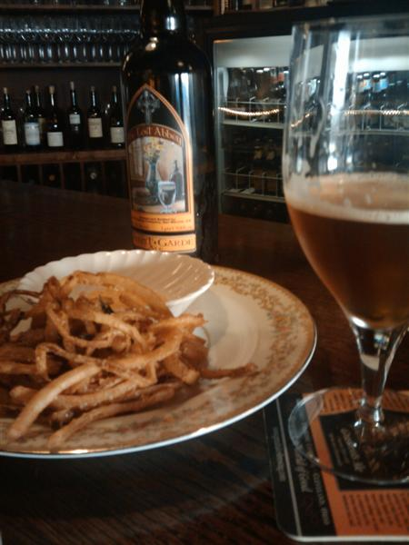 Onion Rings and a Lost Abbey beer at the bar