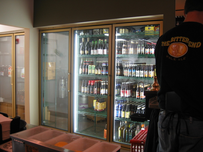 Two Brothers beer cooler behind the bar
