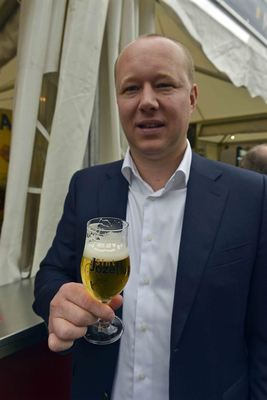 Jef Cornelissen jr, owner of brewery Sint-Jozef, with their Pax Pils