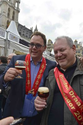 Jef Versele (left), owner of brewery Van Steenberghe with a Gulden Draak ambassador