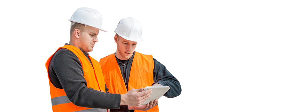 Two construction workers looking at a tablet.
