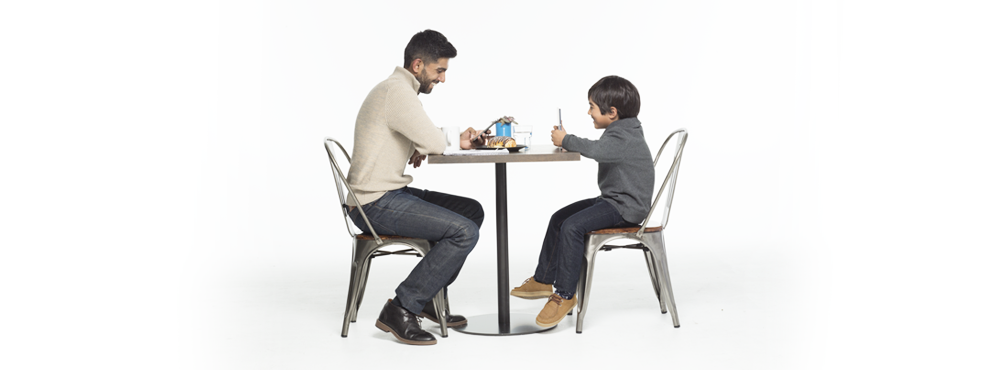 Father and son at table