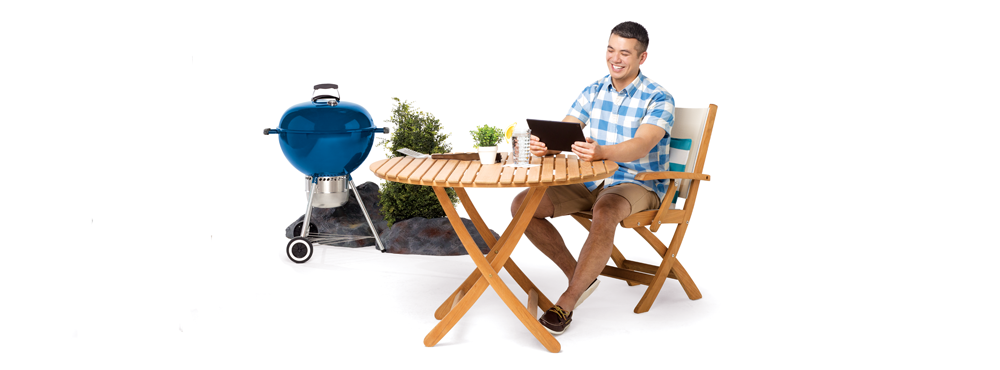 Man sitting at patio table with bbq