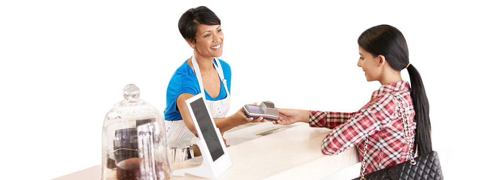 Woman paying for items at store.