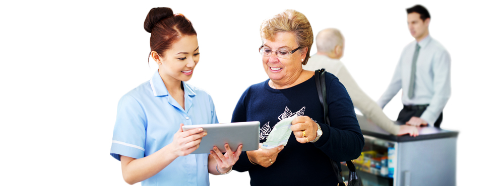 Young woman showing older woman something on a retail tablet.