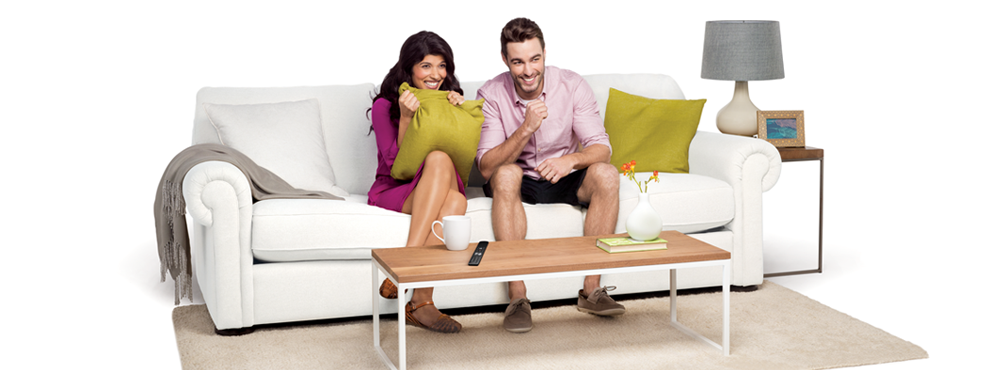 Man and woman watching TV together on couch.