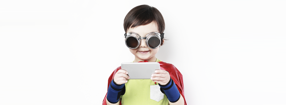 Young boy in a costume looking at a smartphone
