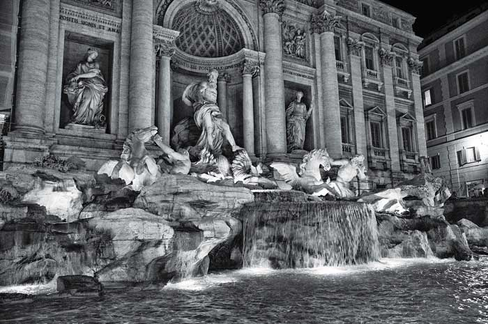 Trevi fountain rome at night in black and white