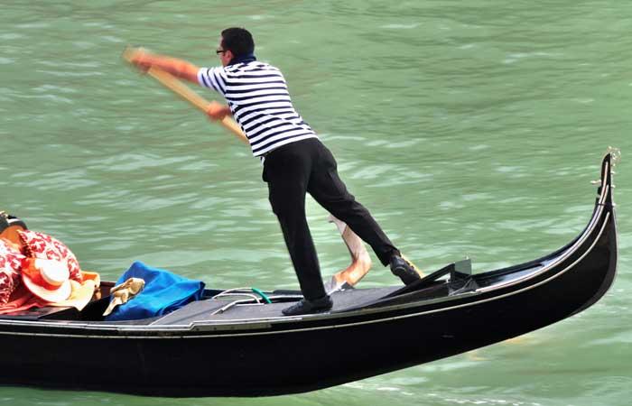 Balancing Act of A Venetian Gondolier