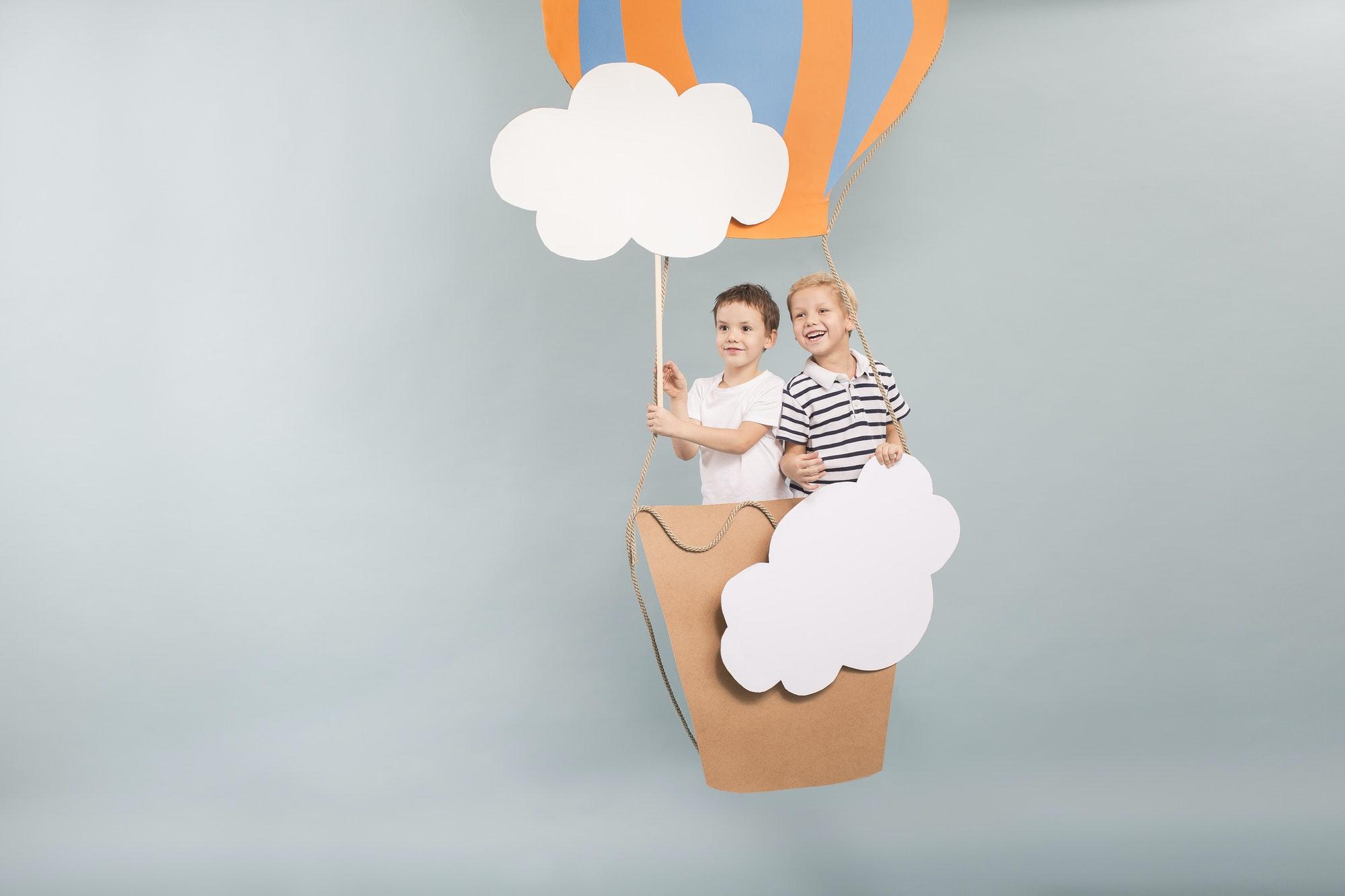Boys flying in baloon