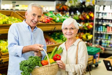 Senior couple grocery shopping.