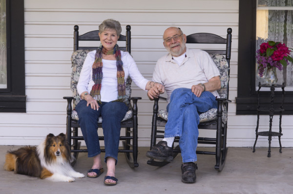 Elderly couple in rocking chairs.