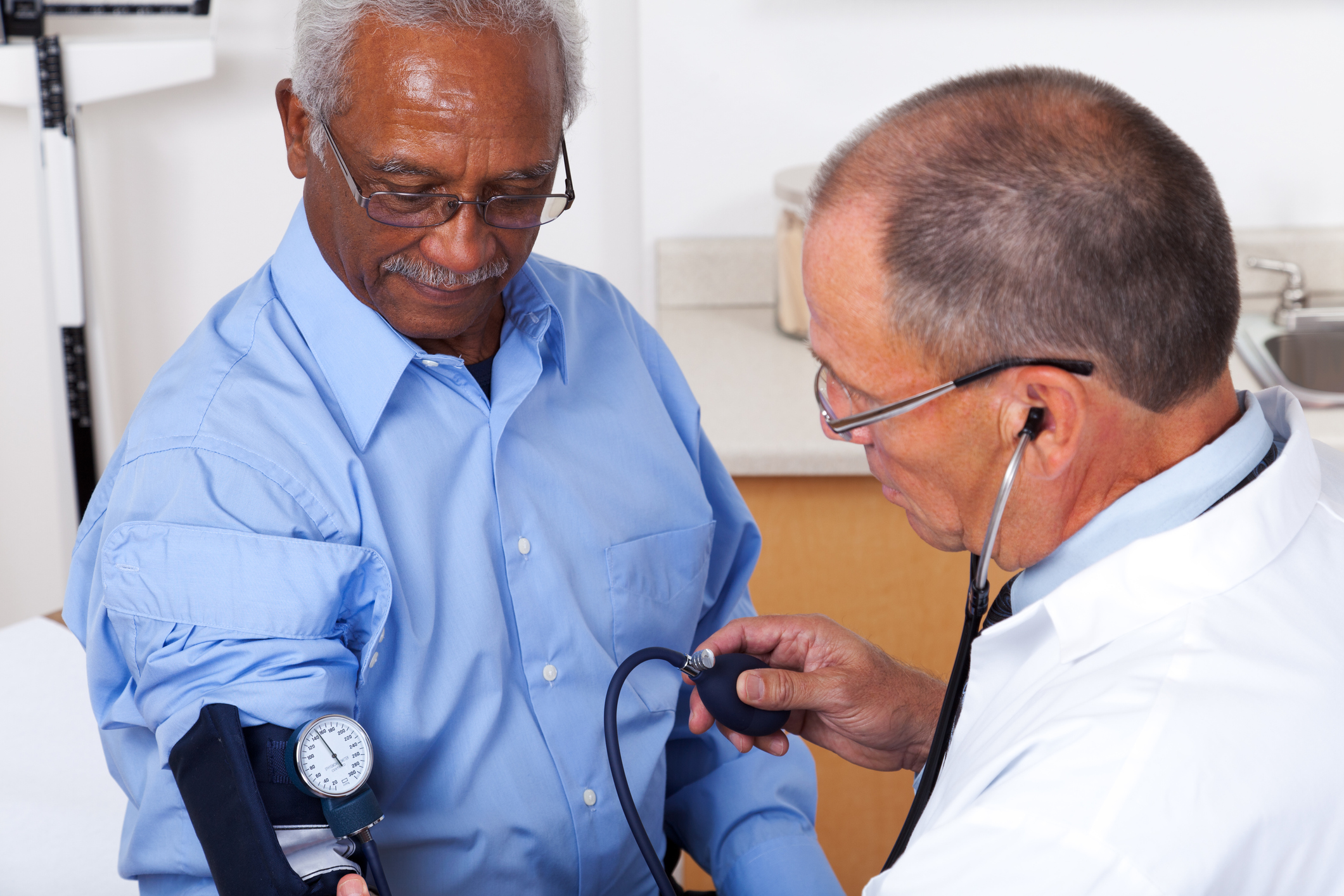 Man having his doctor check his blood pressure