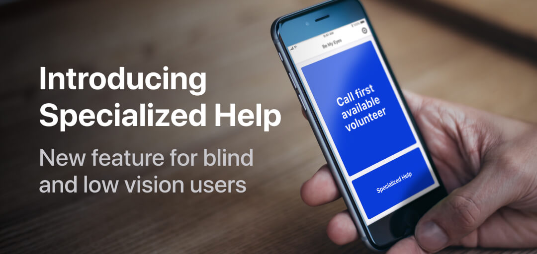 """A handheld iPhone faces us showcasing a new button entitled """"Specialized Help"""" on the Be My Eyes homescreen."""
