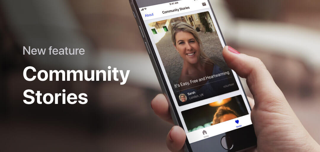 Handheld iPhone depicts the Be My Eyes app's new Community Stories feature.