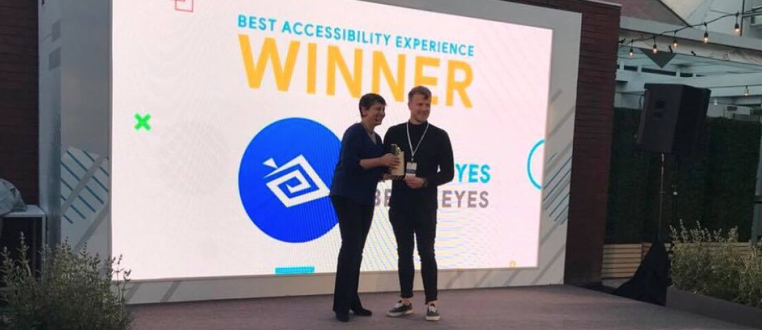 Be My Eyes Community Director, Alexander, accepting the Google Play award on stage.