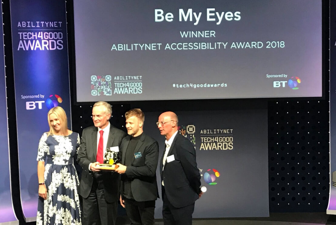 Be My Eyes Community Director, Alexander Hauerslev Jensen, accepting the Abilitynet Accessibility Award at the 2018 Tech4Good Awards in London, UK.