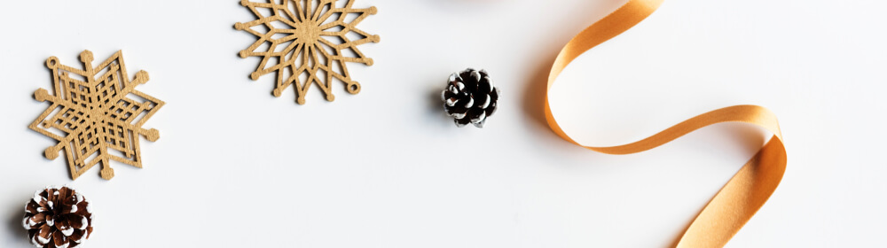 A selection of different types of Christmas decorations on a white table.