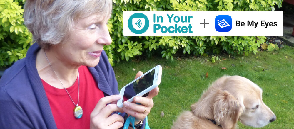 """Woman uses the In Your Pocket phone. She is in her garden with her dog. In the top right corner the picture says: """"In Your Pocket + Be My Eyes""""."""