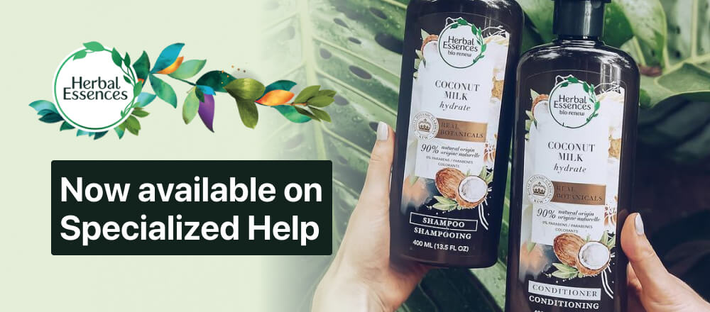 Someone uses Be My Eyes to read the label on two Herbal Essences bottles, coconut milk shampoo and conditioner accompanied by the  Herbal Essences logo along with the text 'Now available on Specialized Help'.