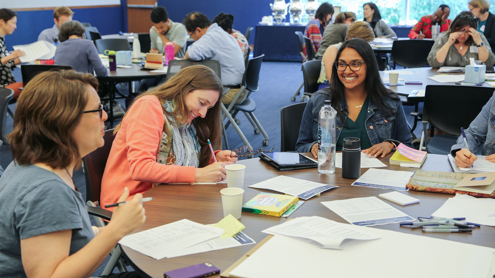 Participants enjoy a lighter moment during table discussions.