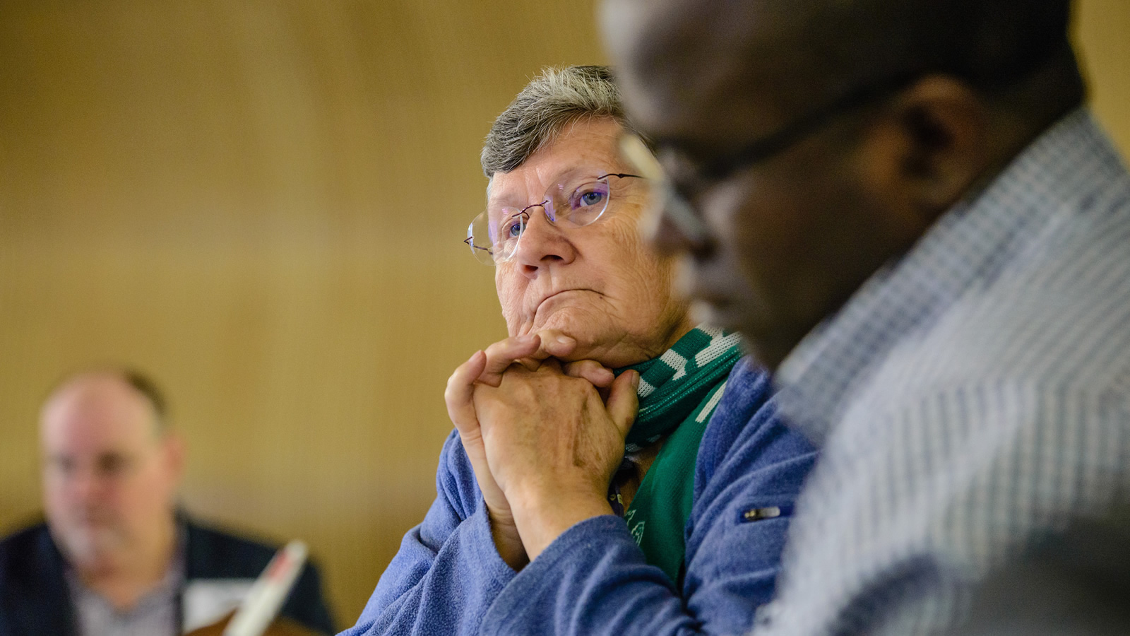A participant listens.