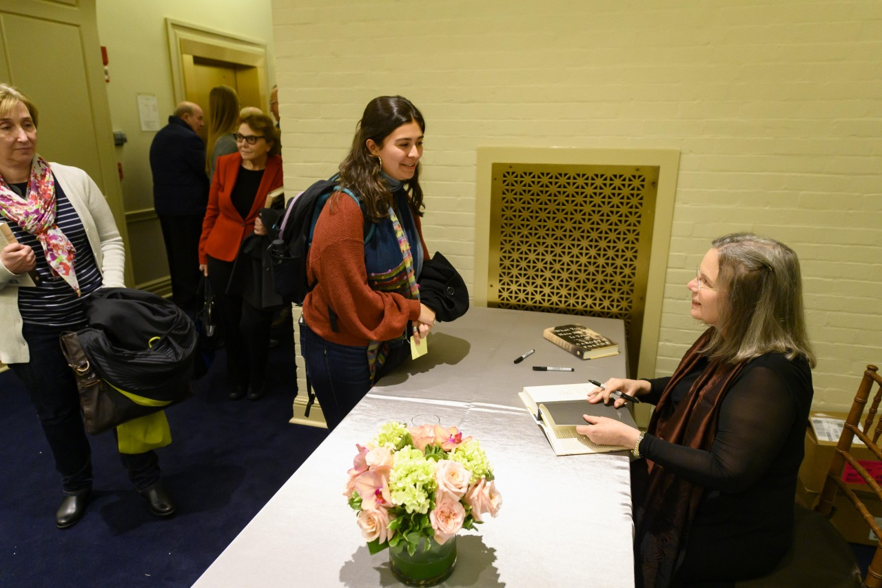 Carolyn Forché signs books following the event.