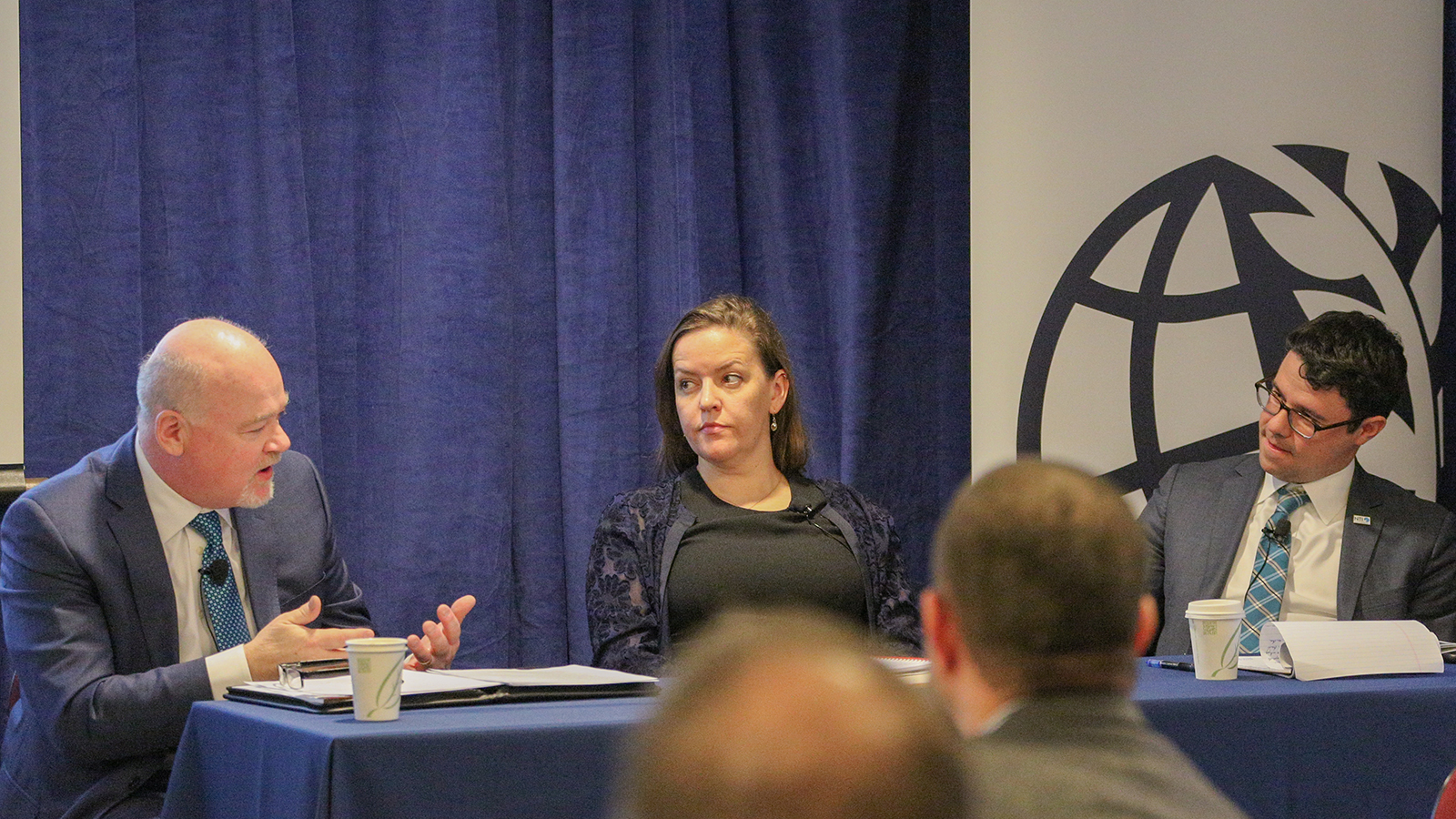 """Status Report: Arms Control and Non-proliferation"" panel featuring Alexandra Bell, Richard Love, and Leon Ratz."
