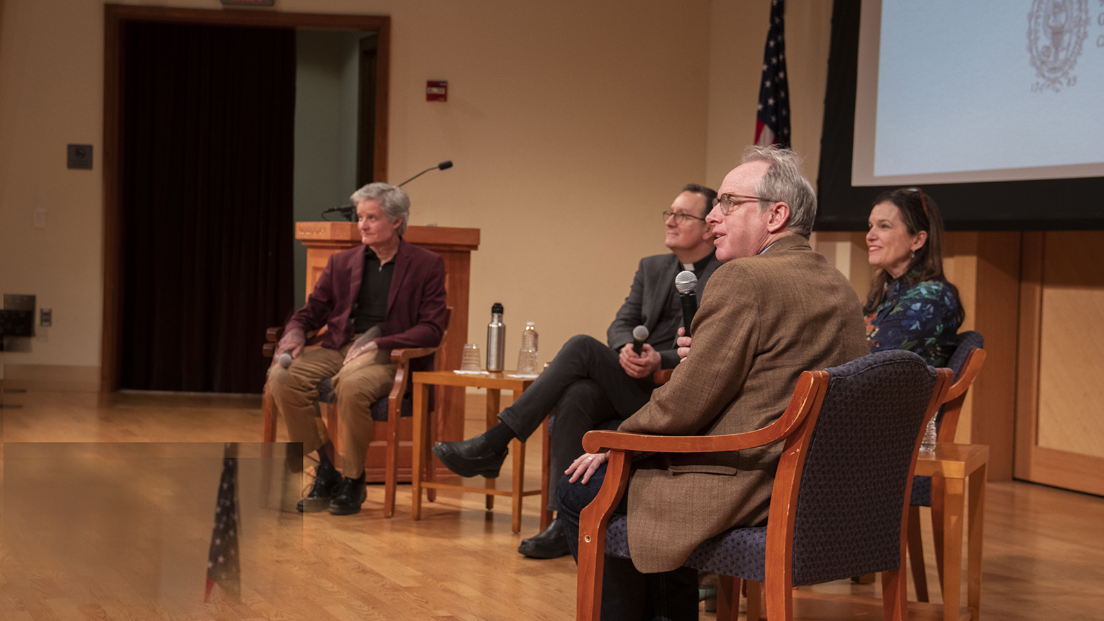 Rev. Mark Bosco, S.J., Elizabeth Coffman, Paul Elie, and Ted Hardin take a question from the audience.