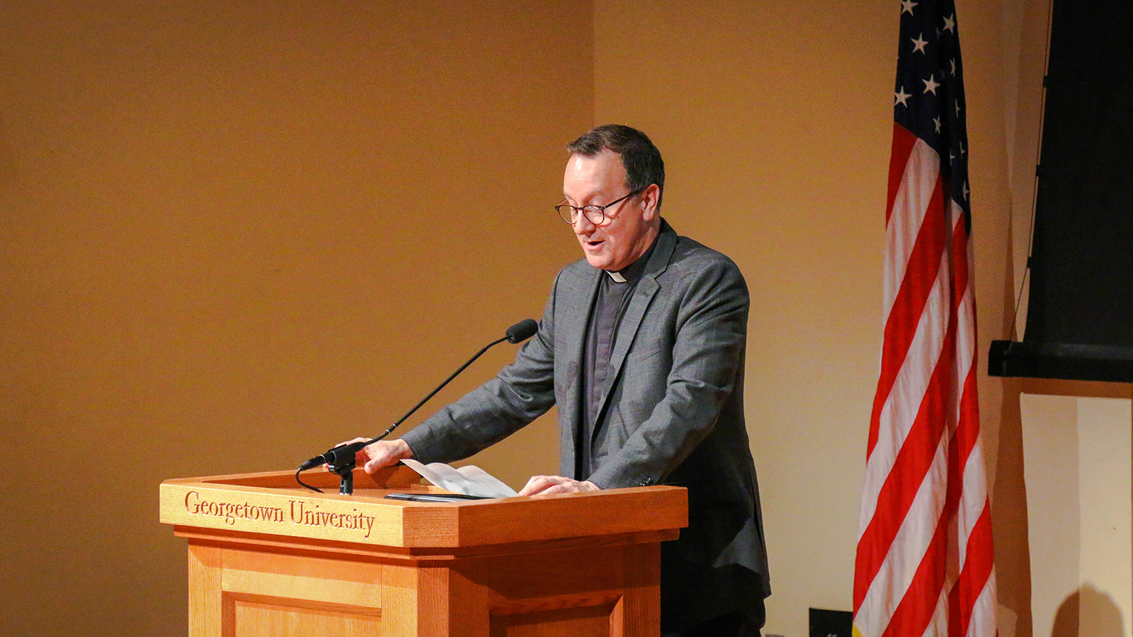 Rev. Mark Bosco, S.J., vice president for mission and ministry, at the podium.