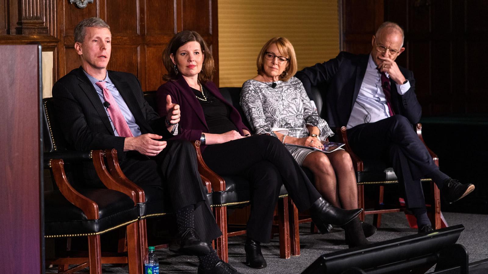 Panelists Mike Mitchell, Rachel Peric, Joan Rosenhauer, and Hans Van de Weerd discuss the migration crisis