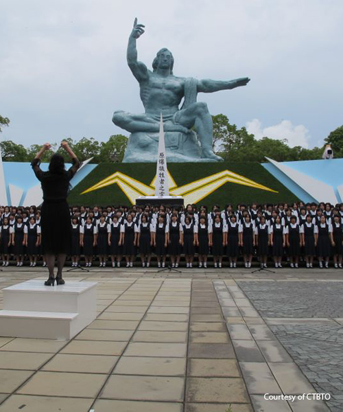 "Junshin high school students singing ""One Thousand Paper Cranes"" at Nagasaki Peace Park. Photo courtesy of CTBTO."