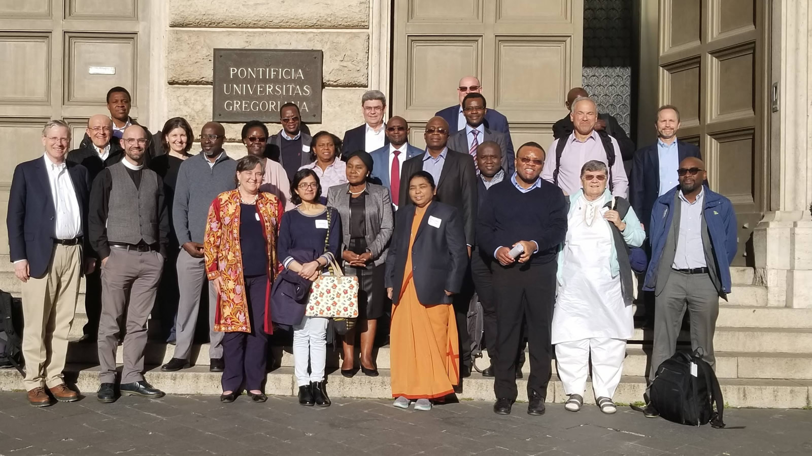 Workshop participants gather outside Pontifical Gregorian University.