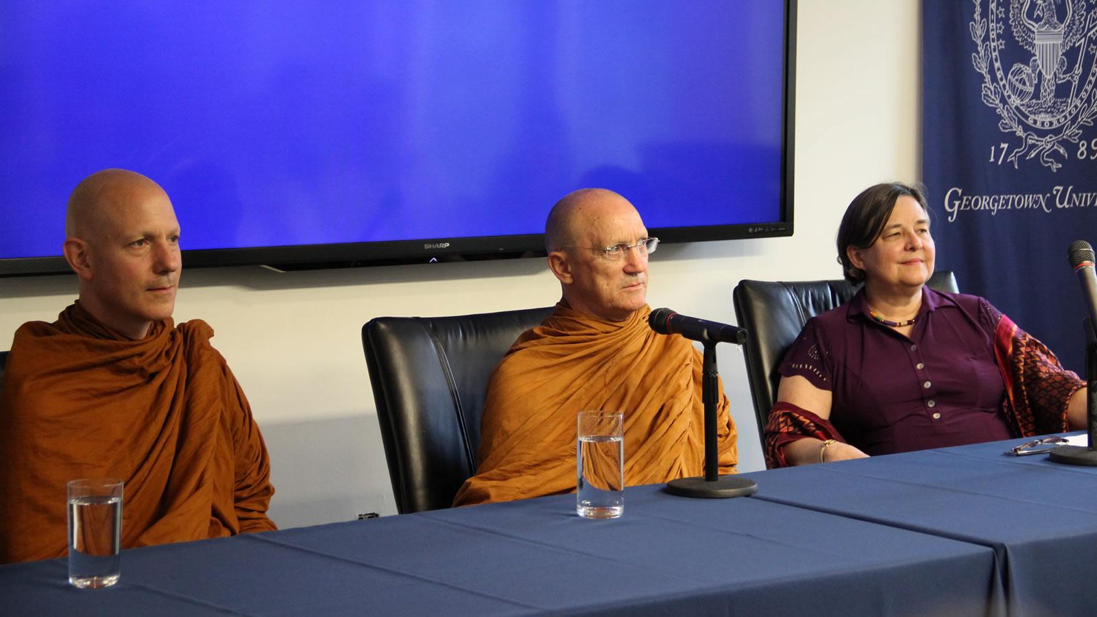 Ajahn Jayanto Bhikku, Ajahn Pasanno Bhikku, and Katherine Marshall listen to an audience question.