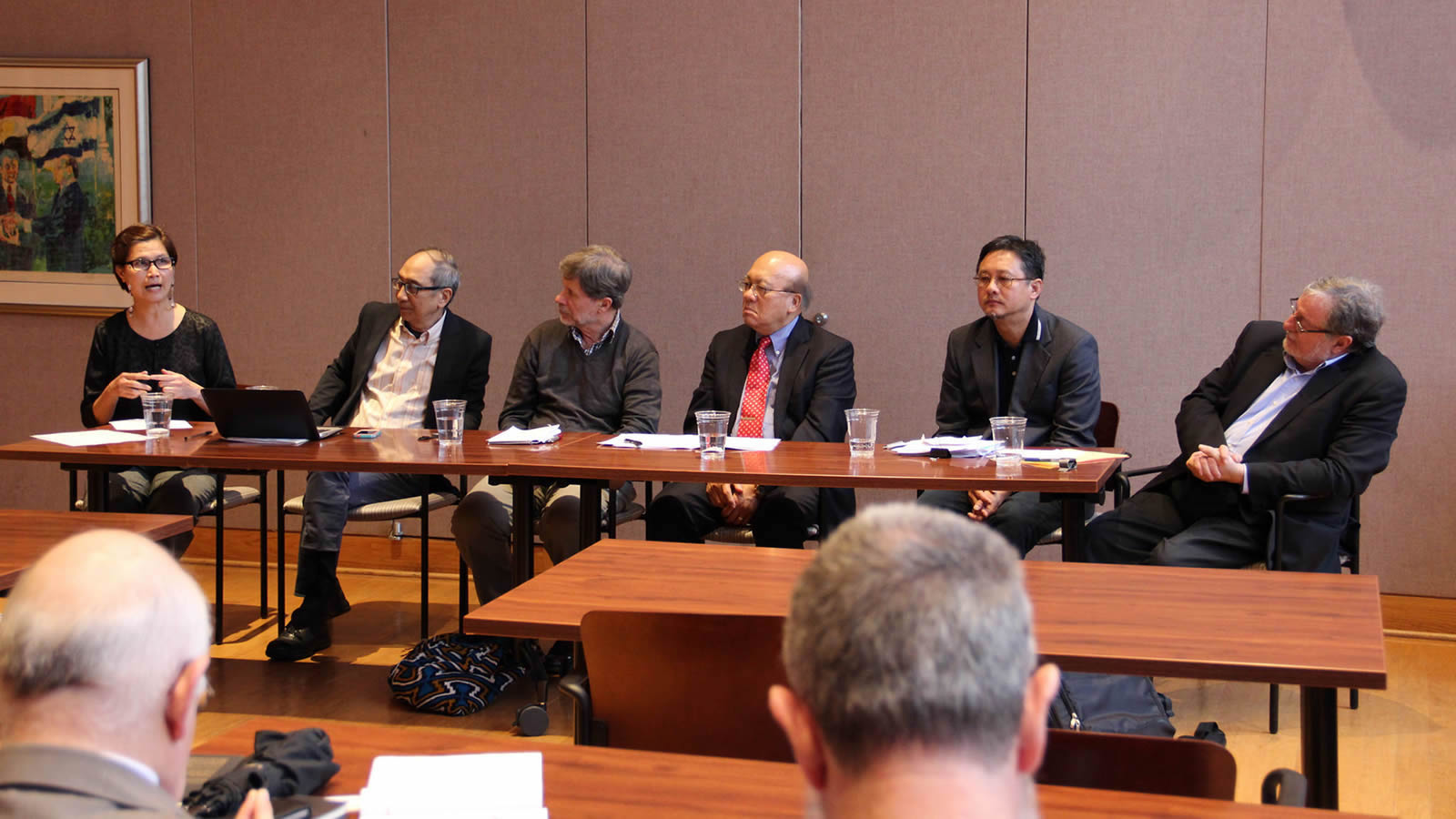 Other panelists listen as Gemma Cruz discusses the future of the Catholic Church in the Asian-Pacific region.