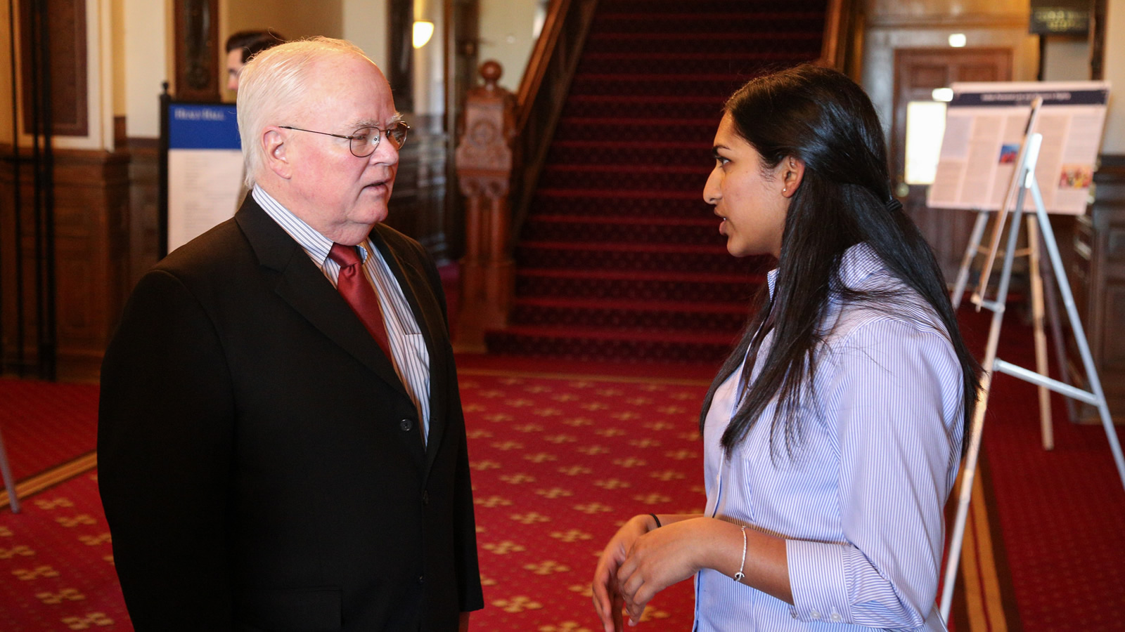 Fr. David Hollenbach, S.J., Talking with student Harshita Nadimpalli