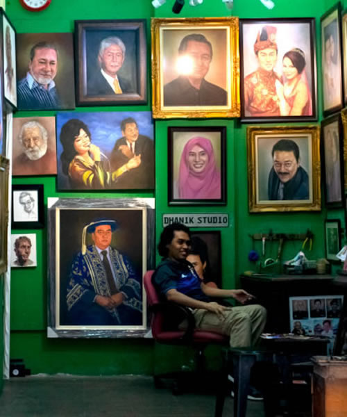 Wall of portraits of Asian people