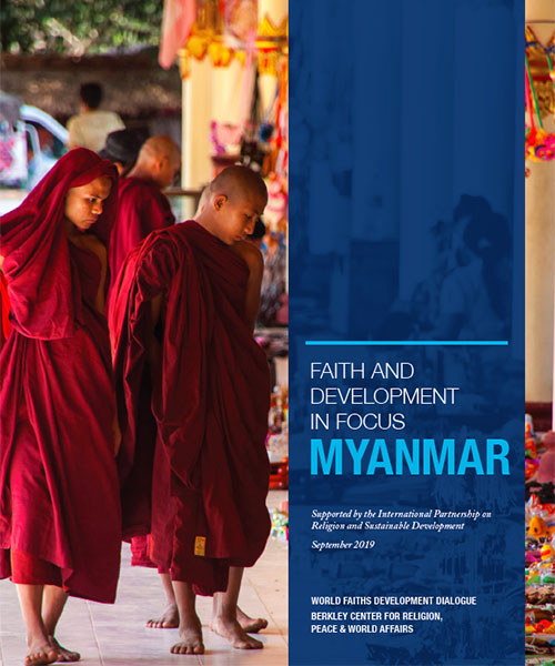 Report cover with photo of red-robed monks