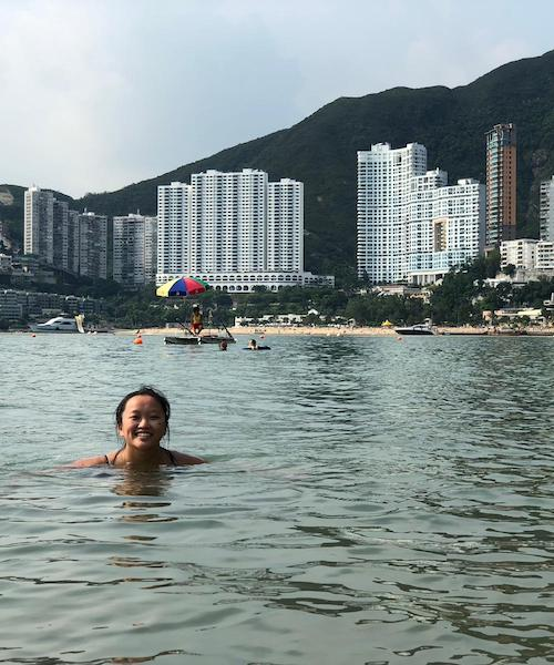 Photo features the author at Middle Bay Beach in Hong Kong, one of many beaches on the East Side of the city.