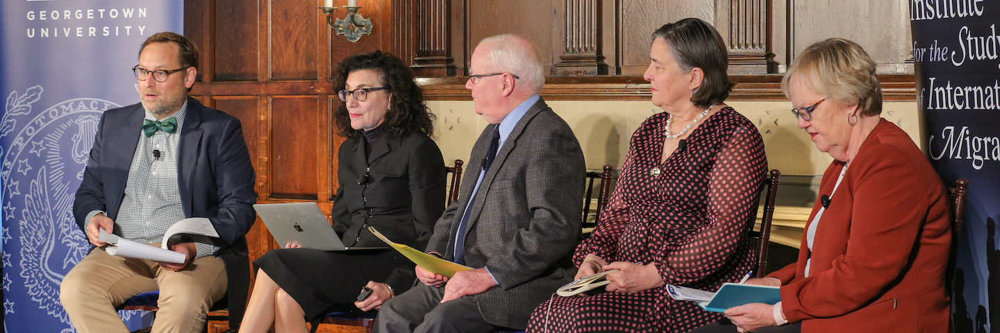Panelists speak at the conference.