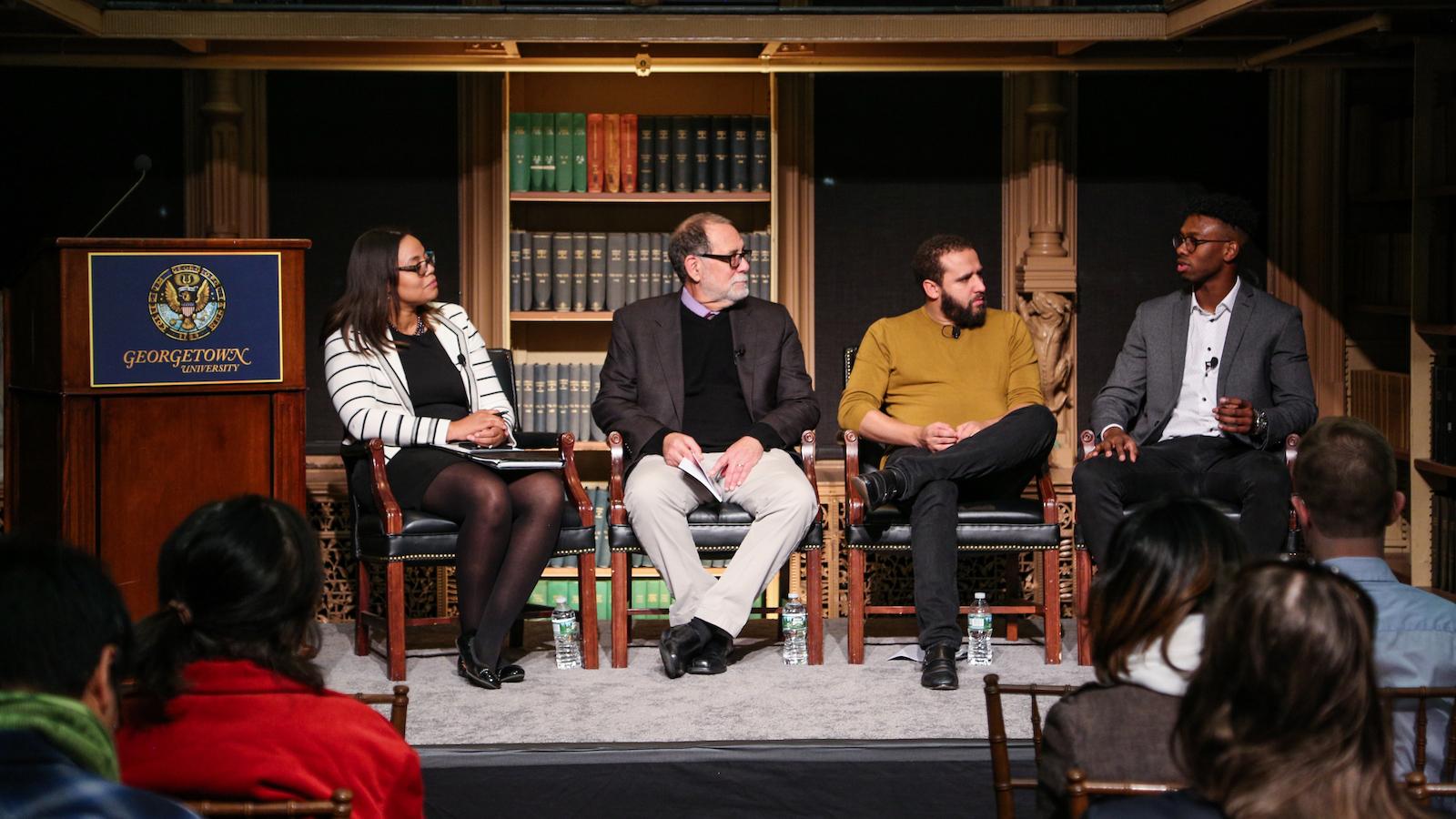 Panelists listen as Teddy Washington describes his experiences