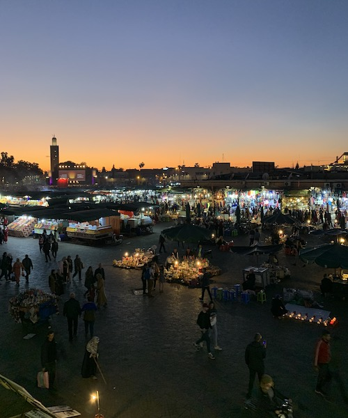 The Marrakech medina at sunset, featuring a mosque at top left.