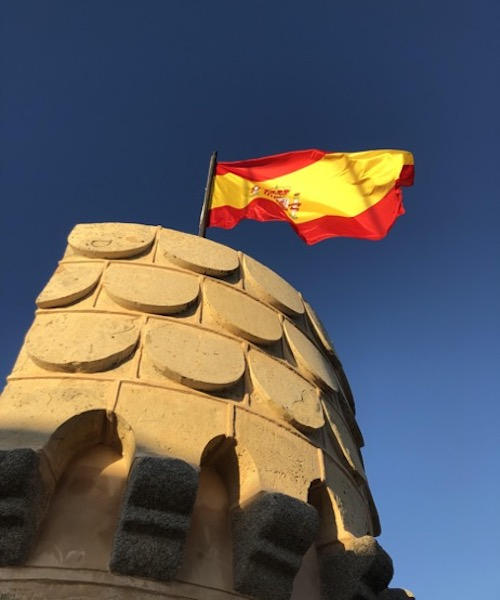 Spanish flag at the top of the Royal Alcazar in Segovia, Spain.