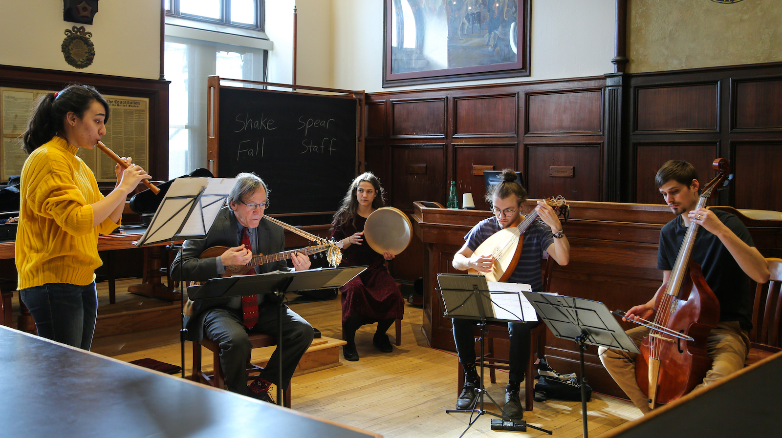 Five musicians playing instruments at a Doyle Seminar performance