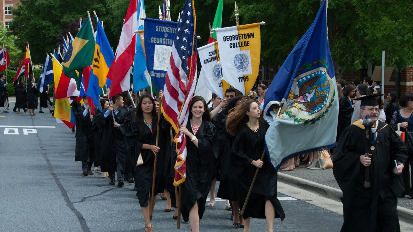 2014 Georgetown Convocation Students Walking With Flags