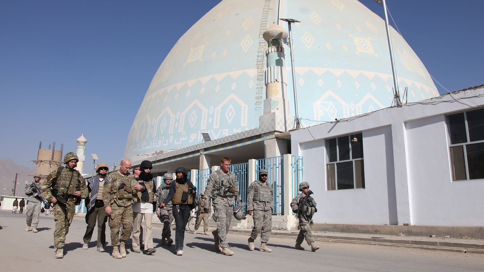 A Multinational Group of Soliders Walks in Front of a Mosque in Kandahar, Afghanistan