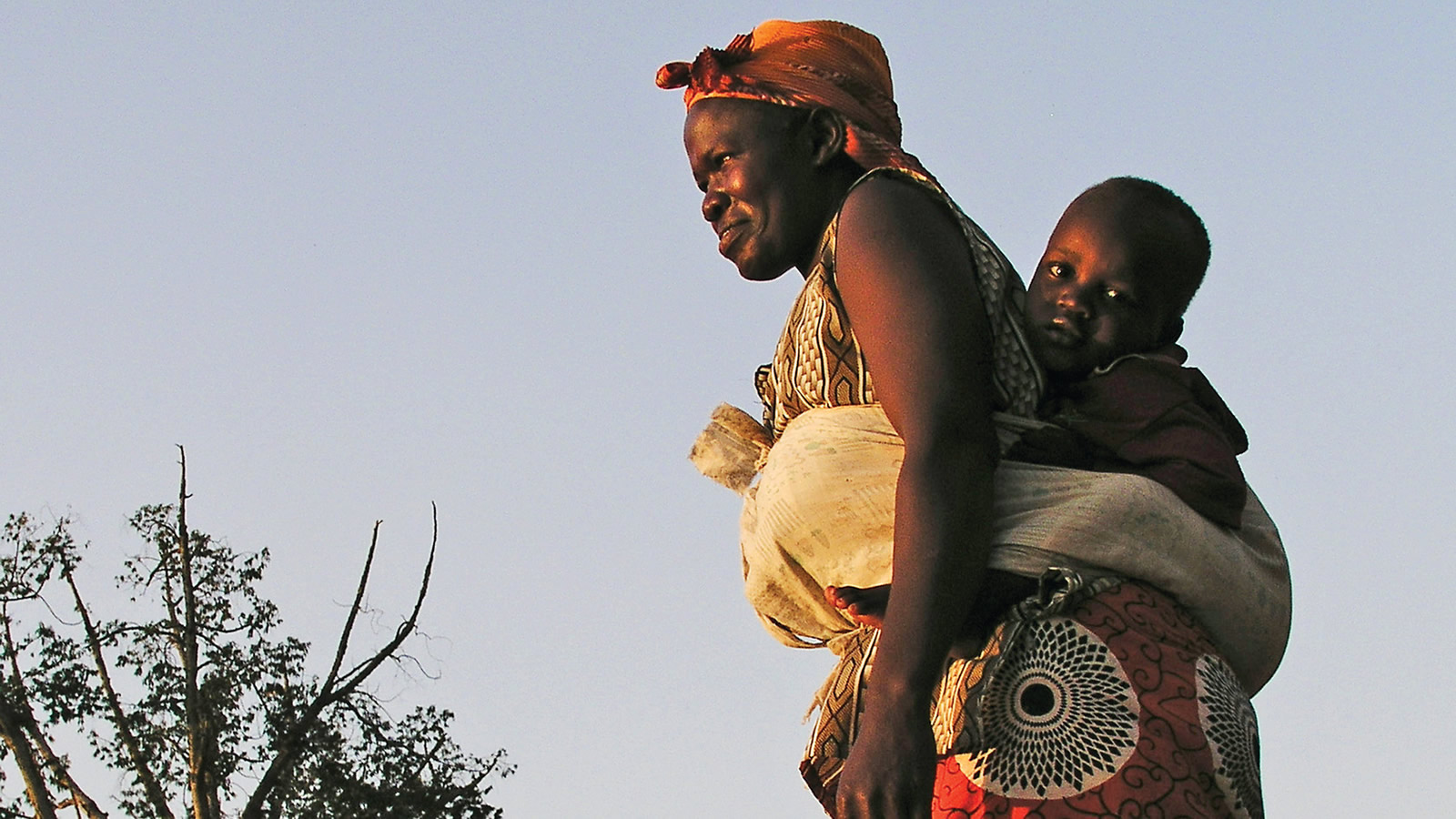 African Woman Carrying Child
